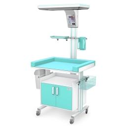 Ogrzewacz noworodkowy IR-10 przy stanowisku do pielęgnacji noworodków